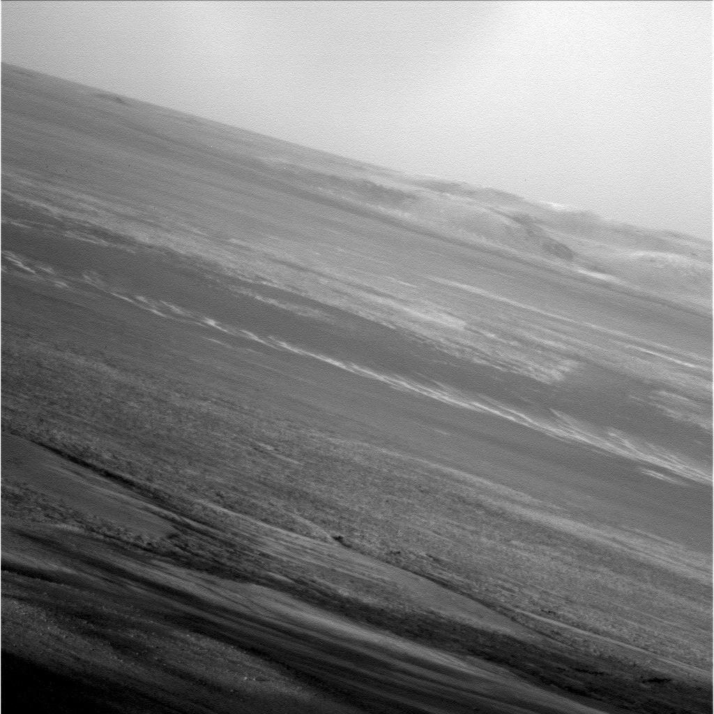 NASA's Mars Exploration Rover Opportunity captured this low-light raw image during the late afternoon of the rover's 2,847th Martian sol (Jan. 27, 2012). The rover is positioned for the Mars winter at 'Greeley Haven'.