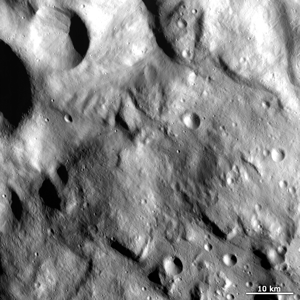This image from NASA's Dawn spacecraft shows the hummocky (wavy/undulating) terrain of Vesta's Rheasilvia quadrangle, which is the south polar region.
