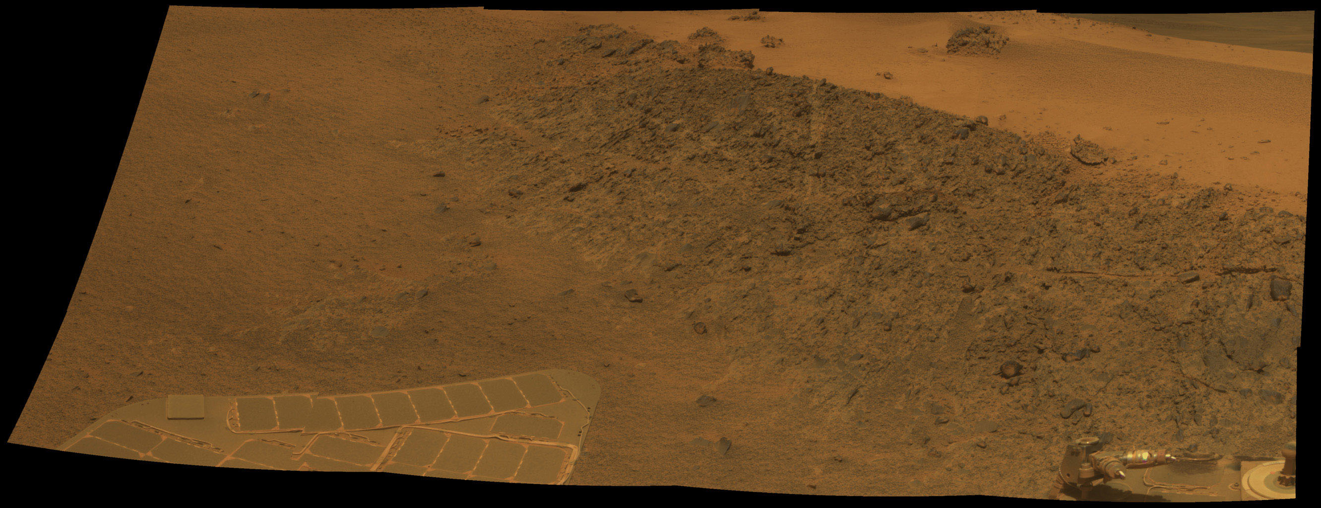 "This mosaic shows a north-facing outcrop, informally named 'Greeley Haven.' The site is near the northern tip of the ""Cape York"" segment of the western rim of Endeavour Crater."