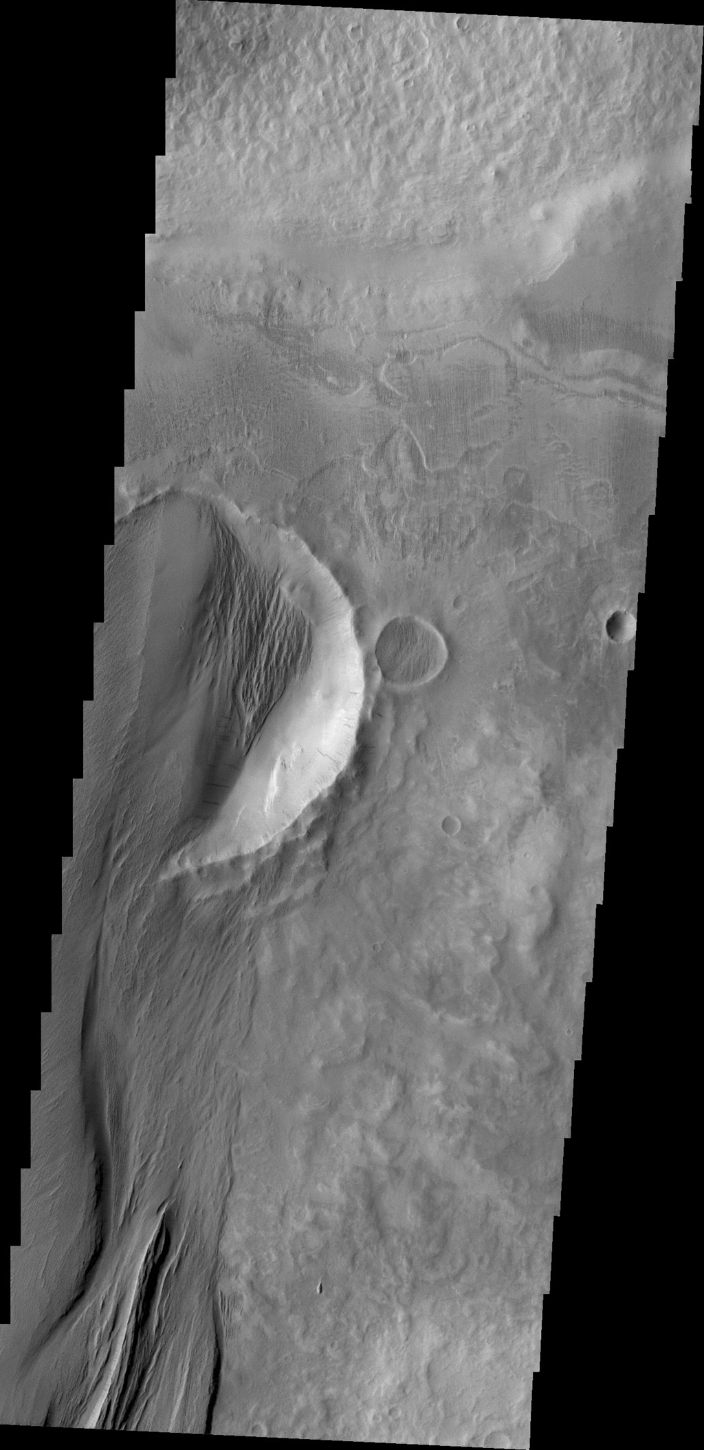 The power of the wind is undeniable in this image of the surface of Mars as seen by NASA's 2001 Mars Odyssey spacecraft.