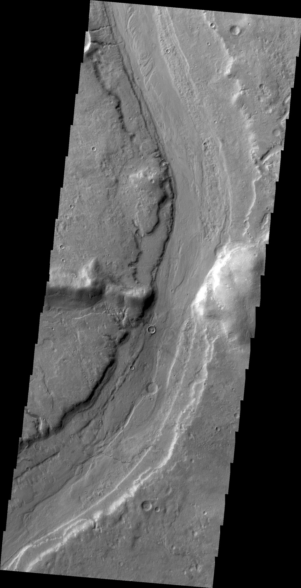 This image captured by NASA's 2001 Mars Odyssey spacecraft shows Reull Vallis where it cuts through the rim of Lipik Crater.