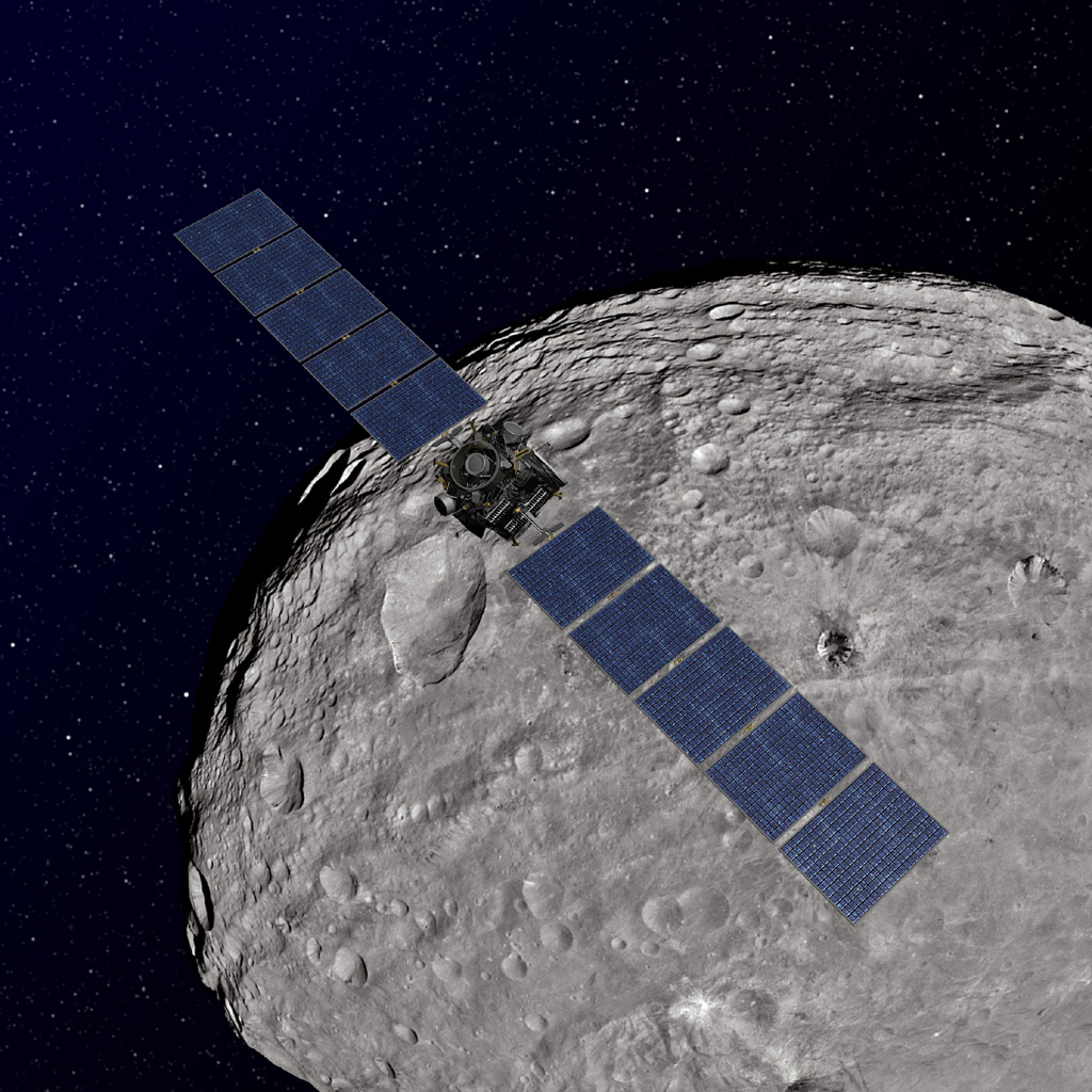 This artist's concept shows NASA's Dawn spacecraft orbiting the giant asteroid Vesta. The depiction of Vesta is based on images obtained by Dawn's framing cameras.