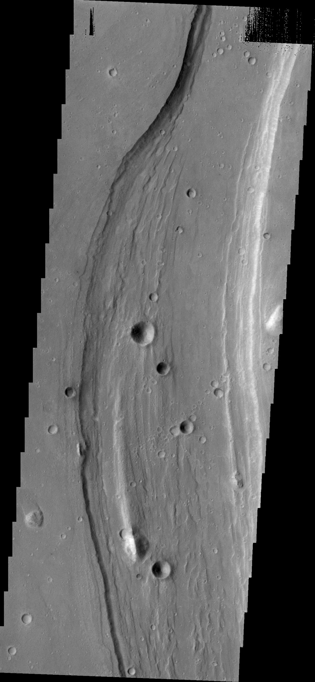 Shalbatana Vallis dominates this image captured by NASA's 2001 Mars Odyssey spacecraft.