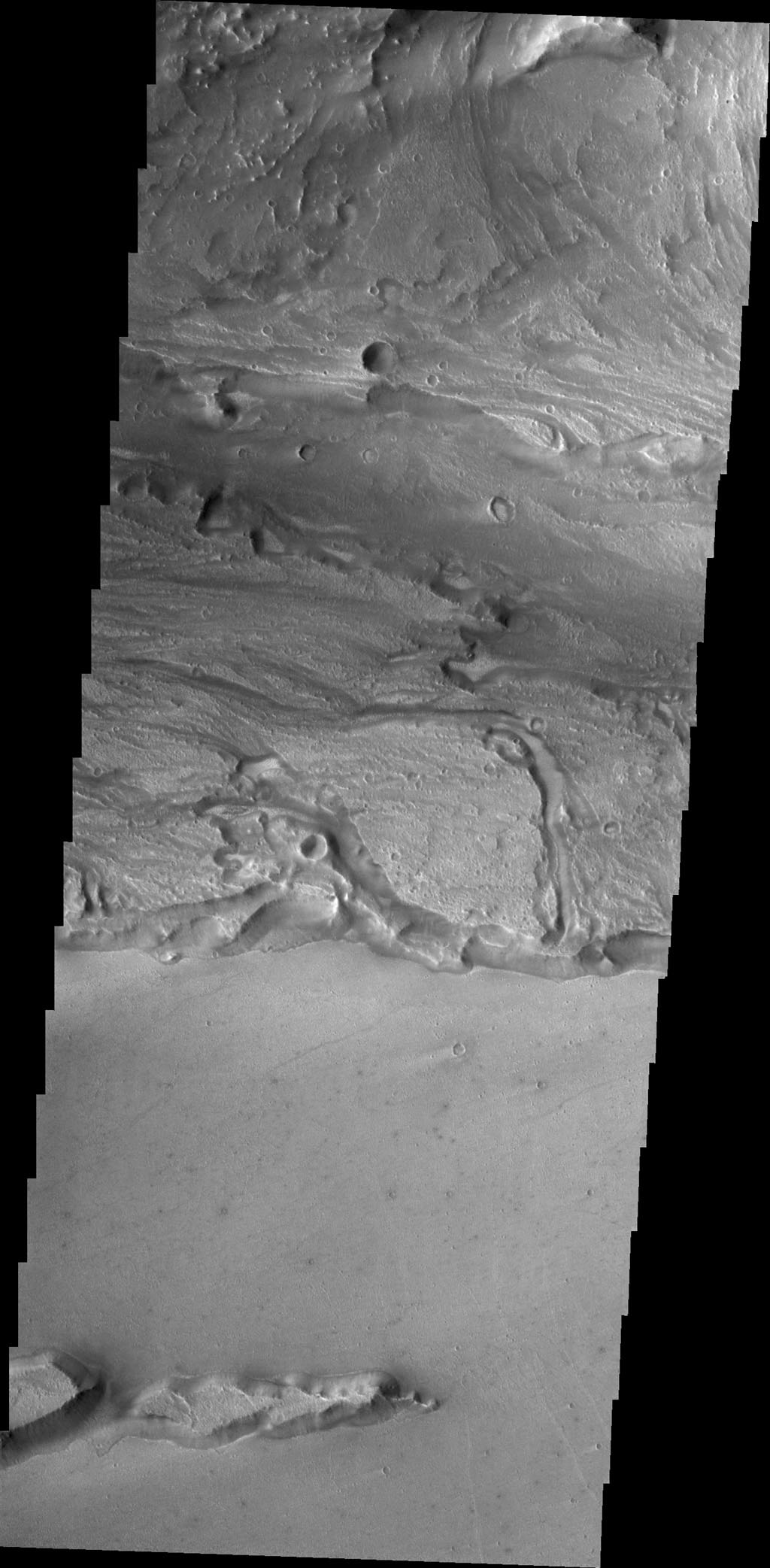 Today's image from NASA's 2001 Mars Odyssey spacecraftshows a small portion of Kasei Valles, one of the largest channel systems on Mars.