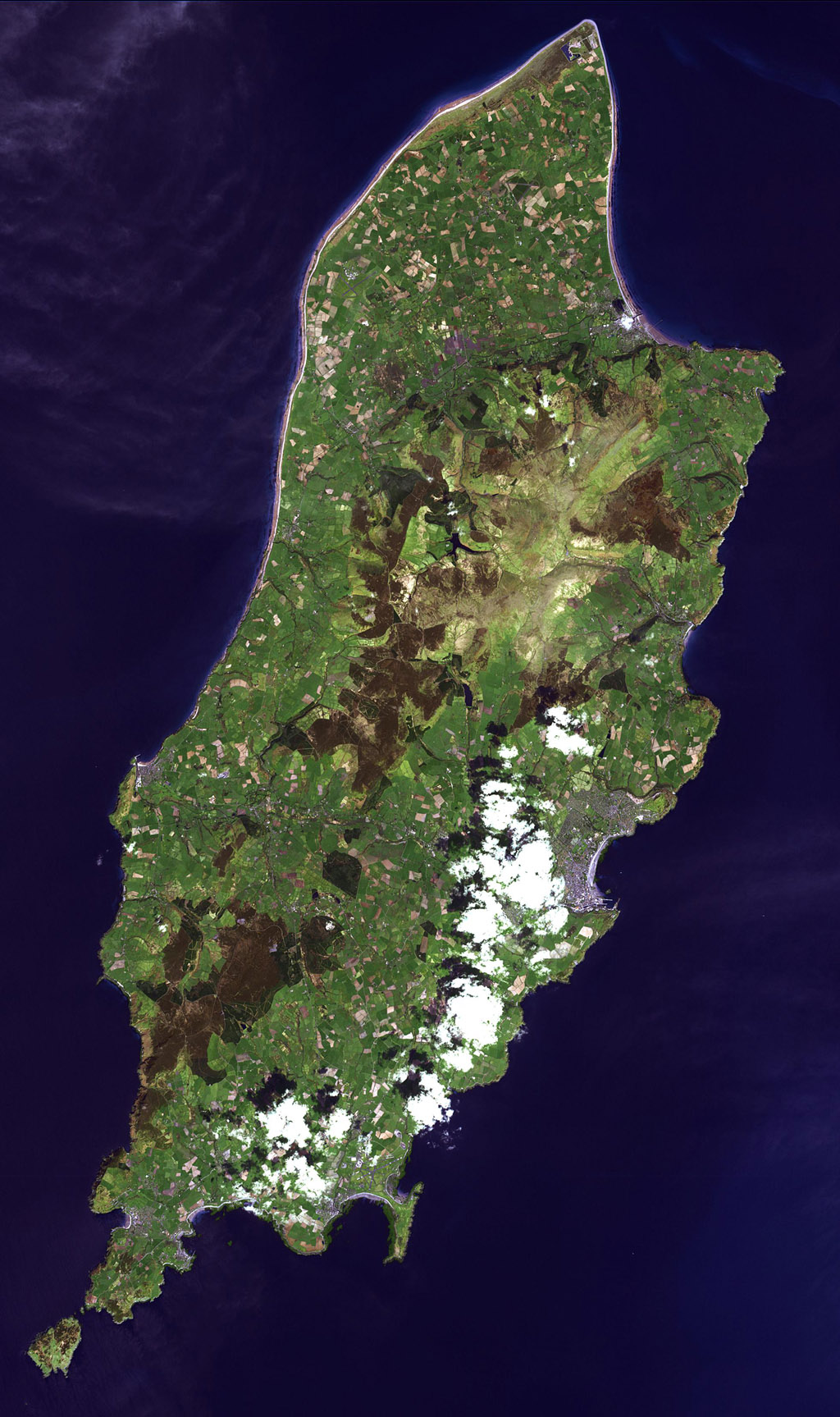 This image from NASA's Terra spacecraft is of the Isle of Man (also known as Mann), a self-governing British Crown Dependency in the Irish Sea between Great Britain and Ireland.