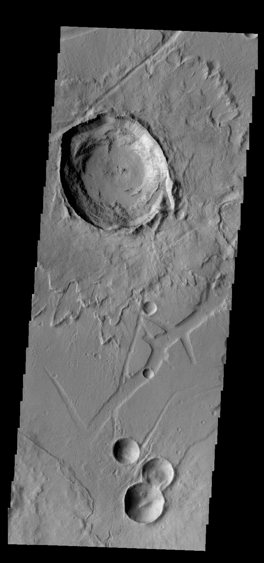 The relatively young Canala Crater and its ejecta overlie the tectonic structures of Labeatis Fossae as seen by NASA's 2001 Mars Odyssey spacecraft.