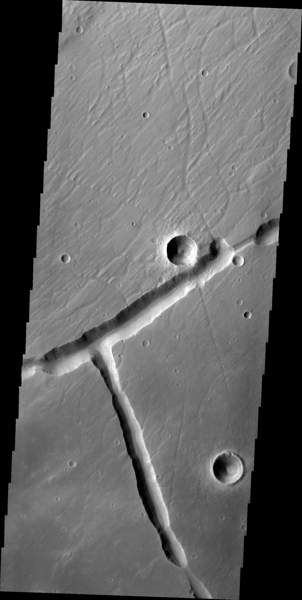Right angles are not common in nature. They are almost always formed by tectonic forces. This right angle on Mars is part of Sacra Fossae. This image is from NASA's 2001 Mars Odyssey spacecraft.