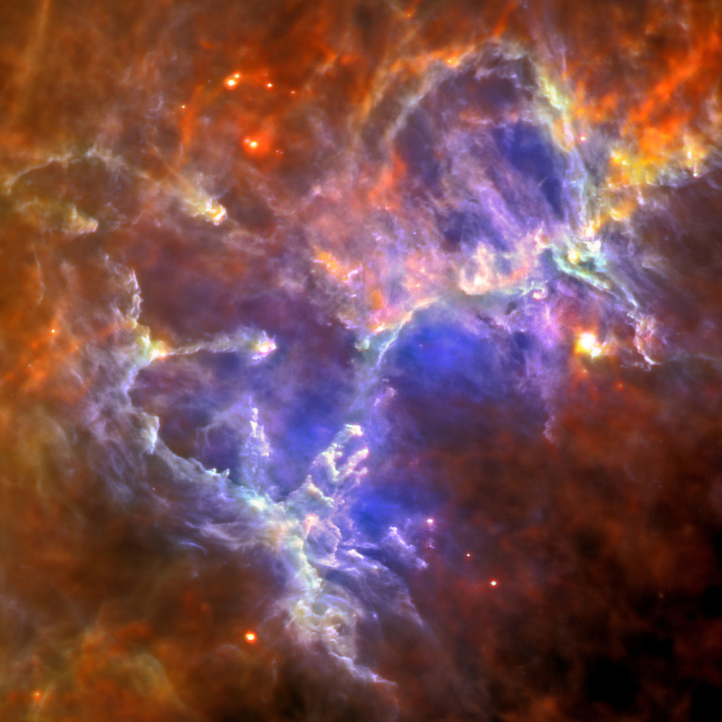This image of the Eagle nebula shows the self-emission of the intensely cold nebula's gas and dust as never seen before; the nebula's intricate tendril nature, with vast cavities forms an almost cave-like surrounding to the famous pillars.