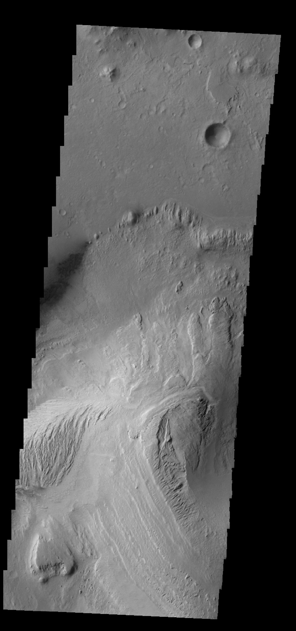 Gale Crater contains a large layered deposit, part of which is shown in this image captured by NASA's 2001 Mars Odyssey spacecraft. This deposit is the target of the Curiosity Lander due to land in early August 2012.
