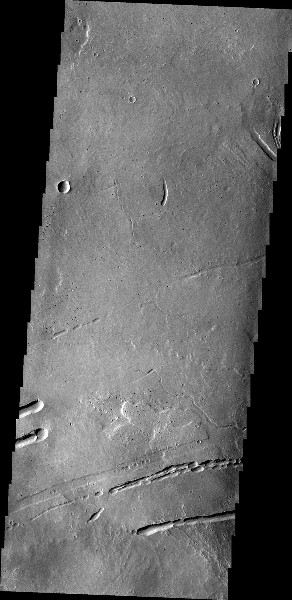 This image captured by NASA's 2001 Mars Odyssey spacecraft shows part of the lava field just off the northern flank of Ascraeus Mons. The depressions are collapse features most likely related to lava tubes below the surface.