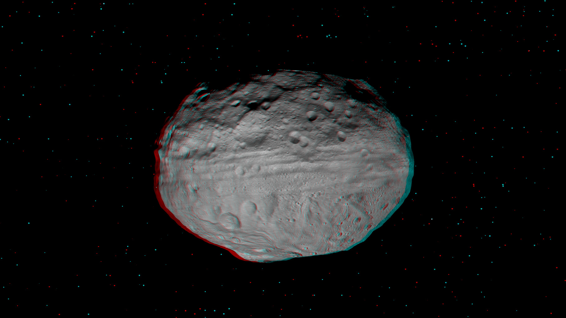 This anaglyph shows the topography of Vesta's eastern hemisphere; equatorial troughs are visible around asteroid Vesta's equator and north of these troughs there are a number of highly degraded, old, large craters. You need 3-D glasses to view this image.