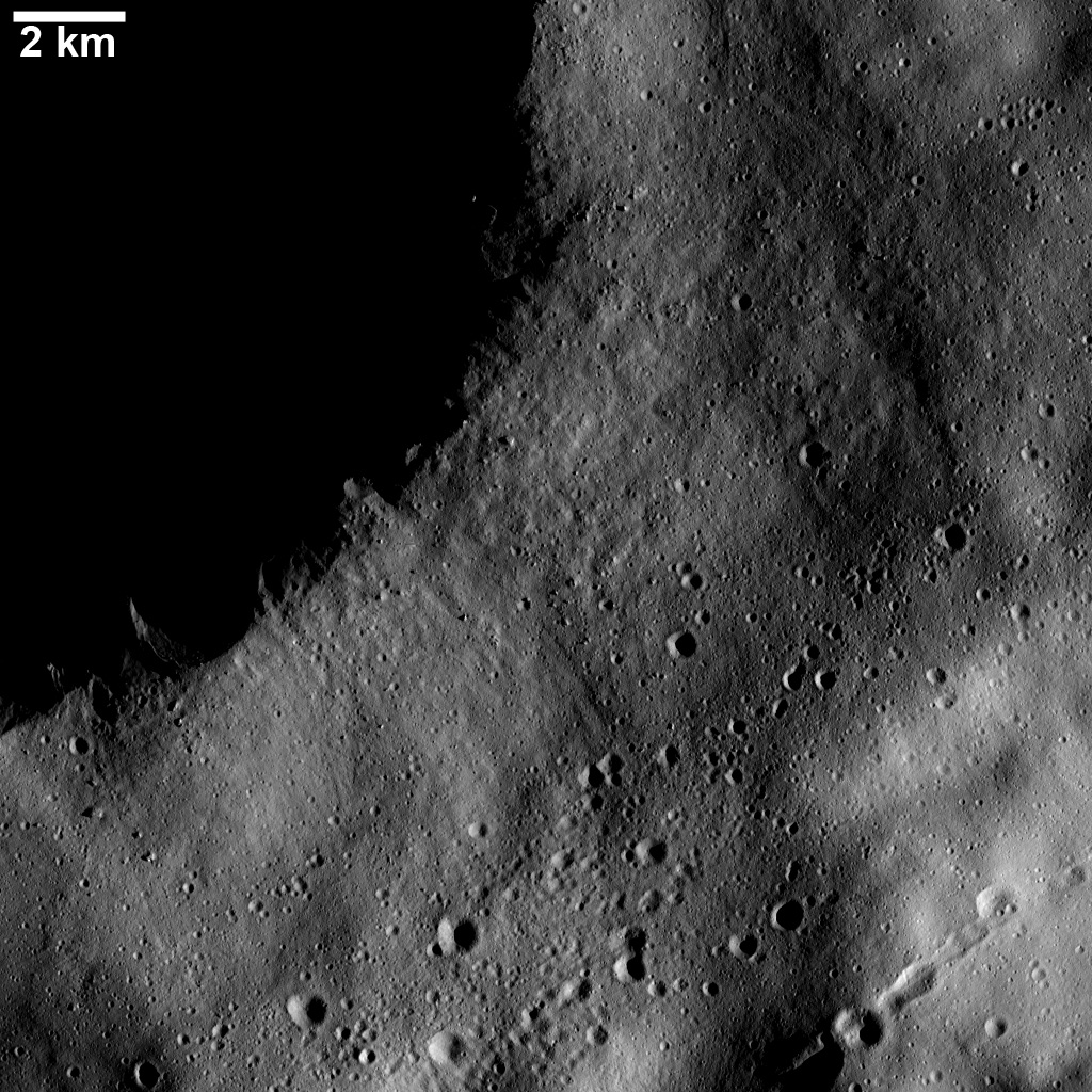 This image from NASA's Dawn spacecraft shows numerous linear chains and clusters of small craters on asteroid Vesta. These chains and clusters of craters were created by material that was ejected during the formation of a large crater.