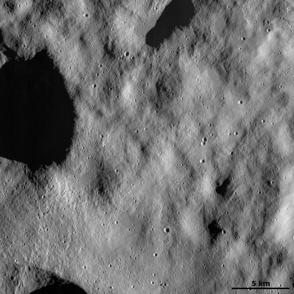 This image from NASA's Dawn spacecraft shows a relatively smooth part of asteroid Vesta's surface. This smooth texture is probably due to the surface being covered in a layer of tiny dust particles.