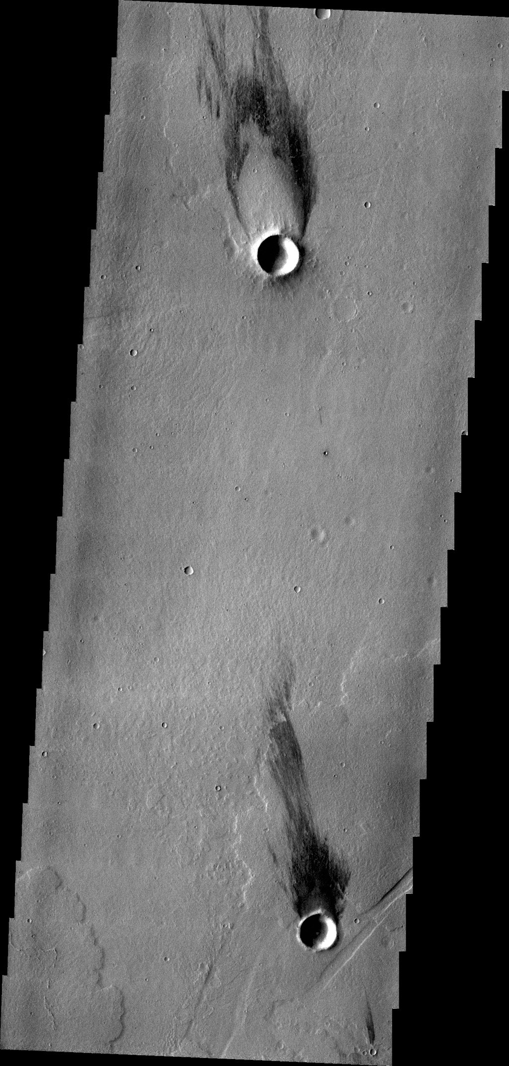 The two windstreaks in this image from NASA's 2001 Mars Odyssey spacecraft are located on volcanic flows southeast of Jovis Tholus.