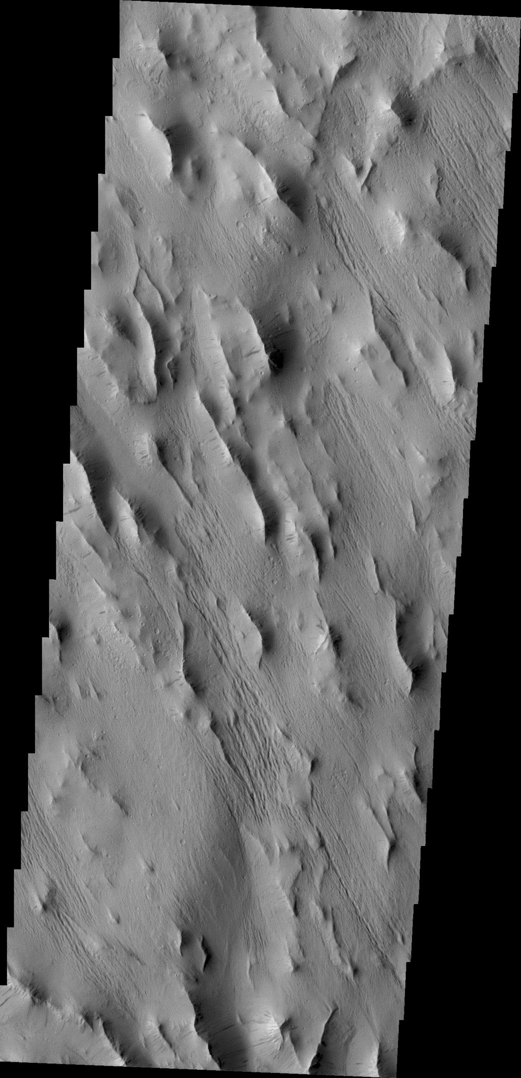 A complexly fractured region, called Lycus Sulci, is found on the western side of Olympus Mons. This image captured by NASA's 2001 Mars Odyssey spacecraft in located in part of Lycus Sulci.