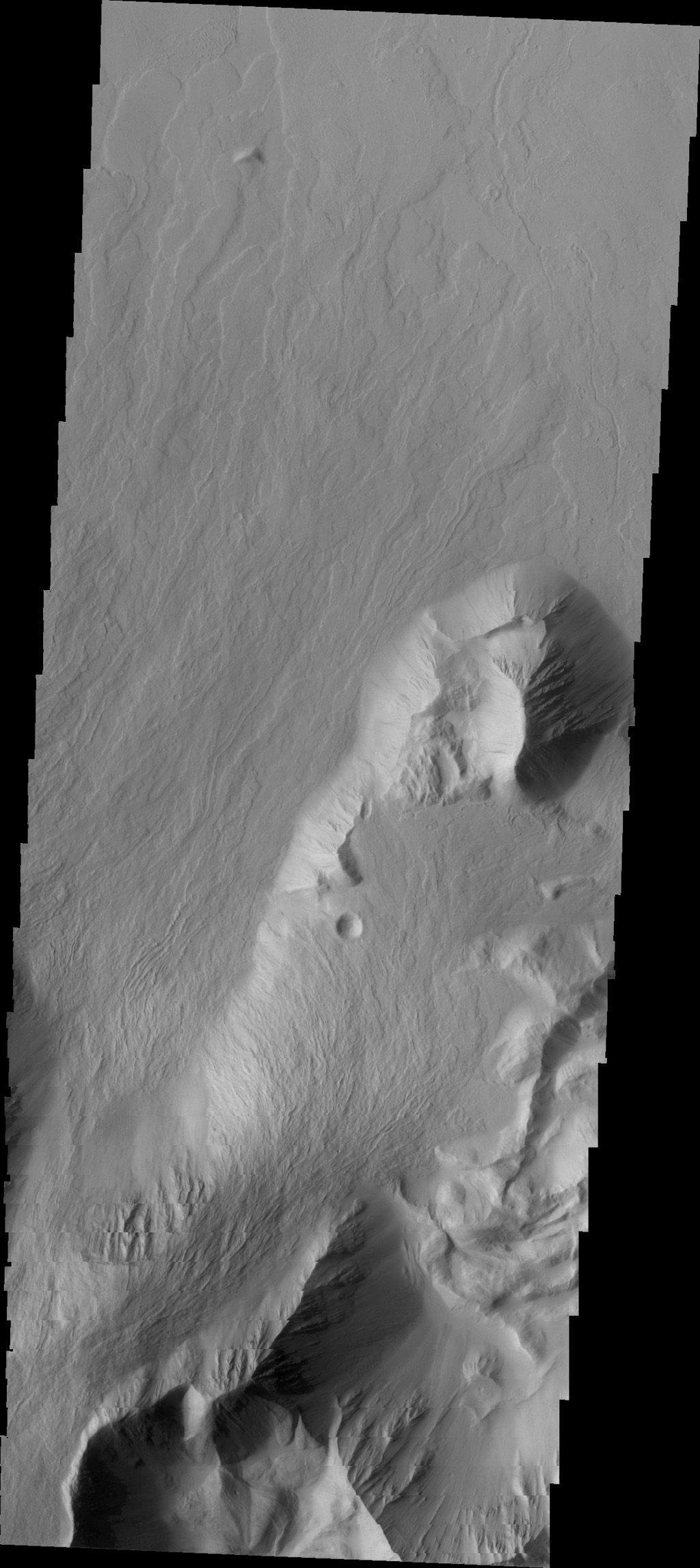 This image captured by NASA's 2001 Mars Odyssey spacecraft shows Olympus Mons is surrounded by an escarpment, called Olympus Rupes, a steep cliff-face between the volcano and the surrounding lava flows on the northeastern side of Olympus Mons.