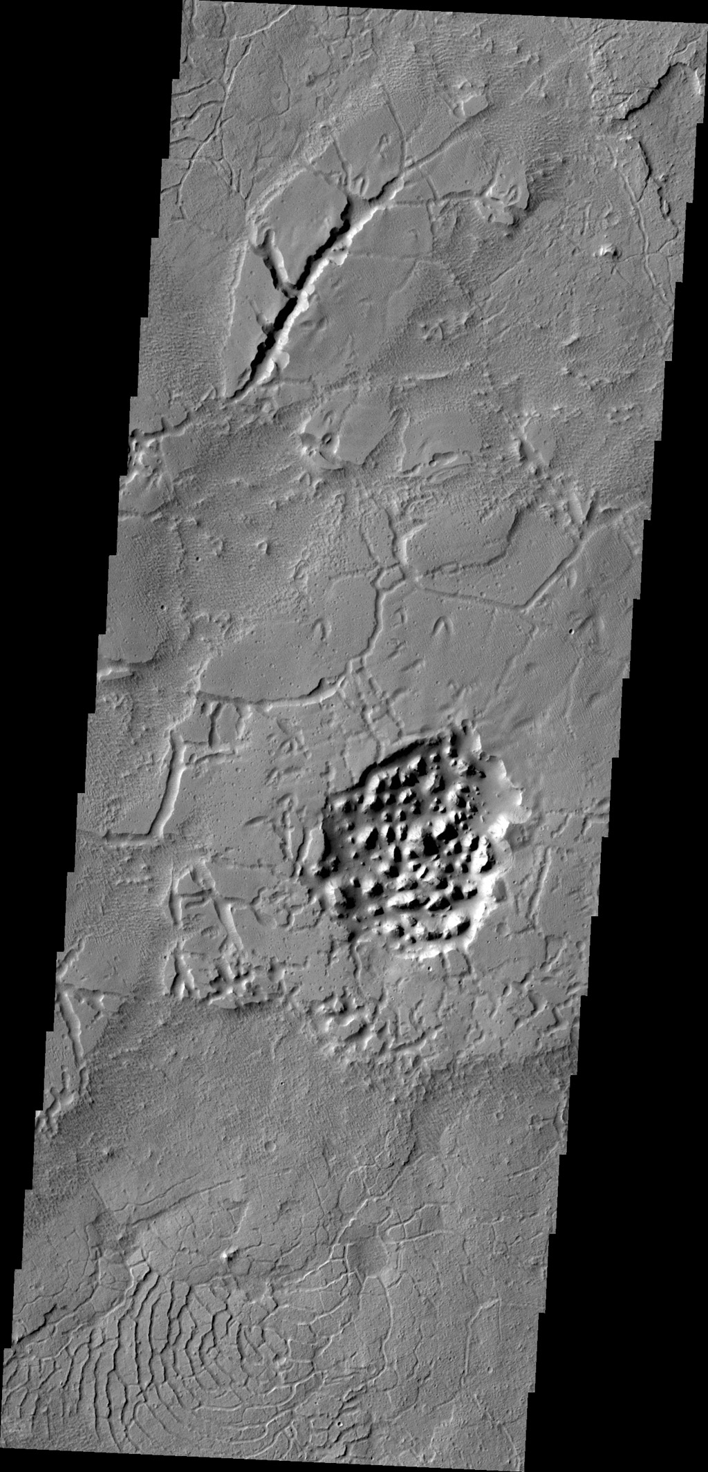 The Avernus region contains several different surface features. These include tectonic fractures, ridges, hills, and regions of chaos within isolated depressions termed cavi. This image was captured by NASA's 2001 Mars Odyssey spacecraft.