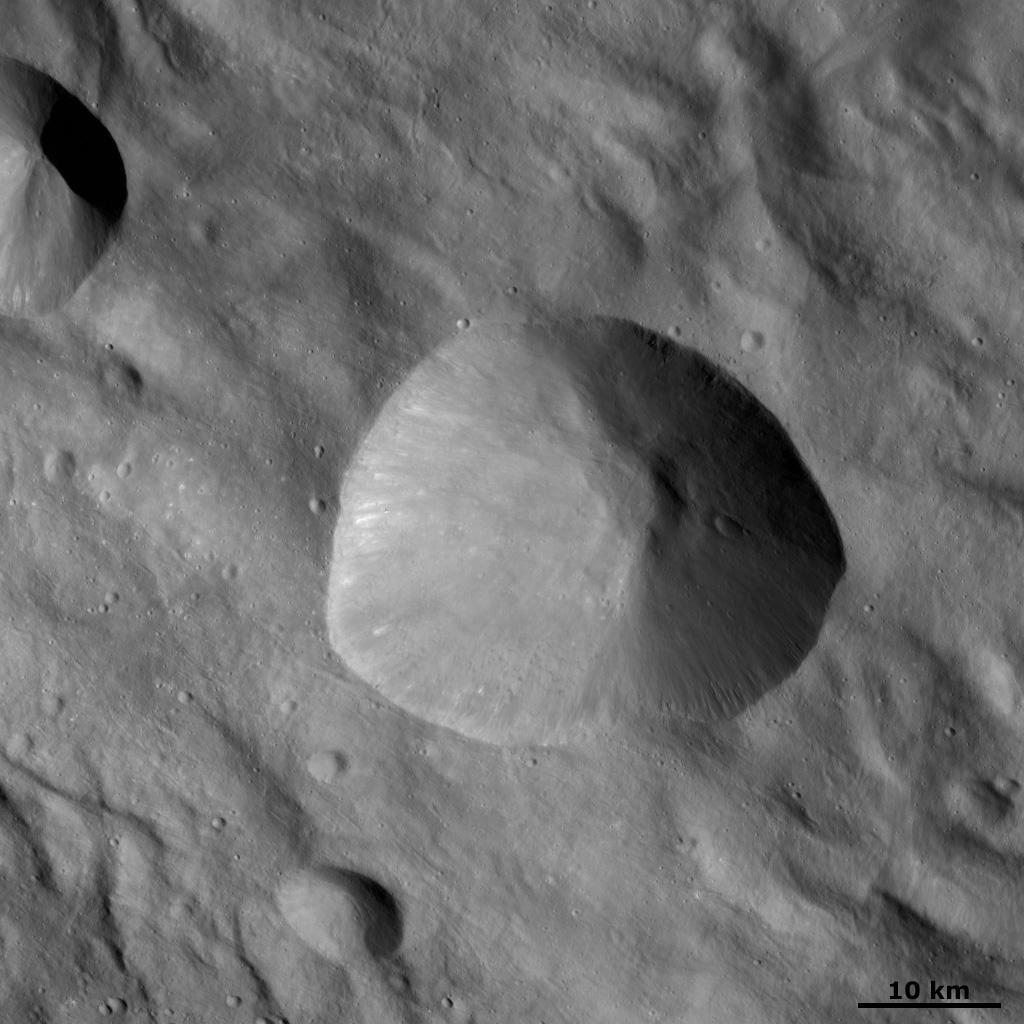 This image from NASA's Dawn spacecraft shows Tarpeia crater, located in Vesta's Rheasilvia quadrangle, near asteroid Vesta's south pole. Tarpeia has a sharp, fresh rim surrounding it.