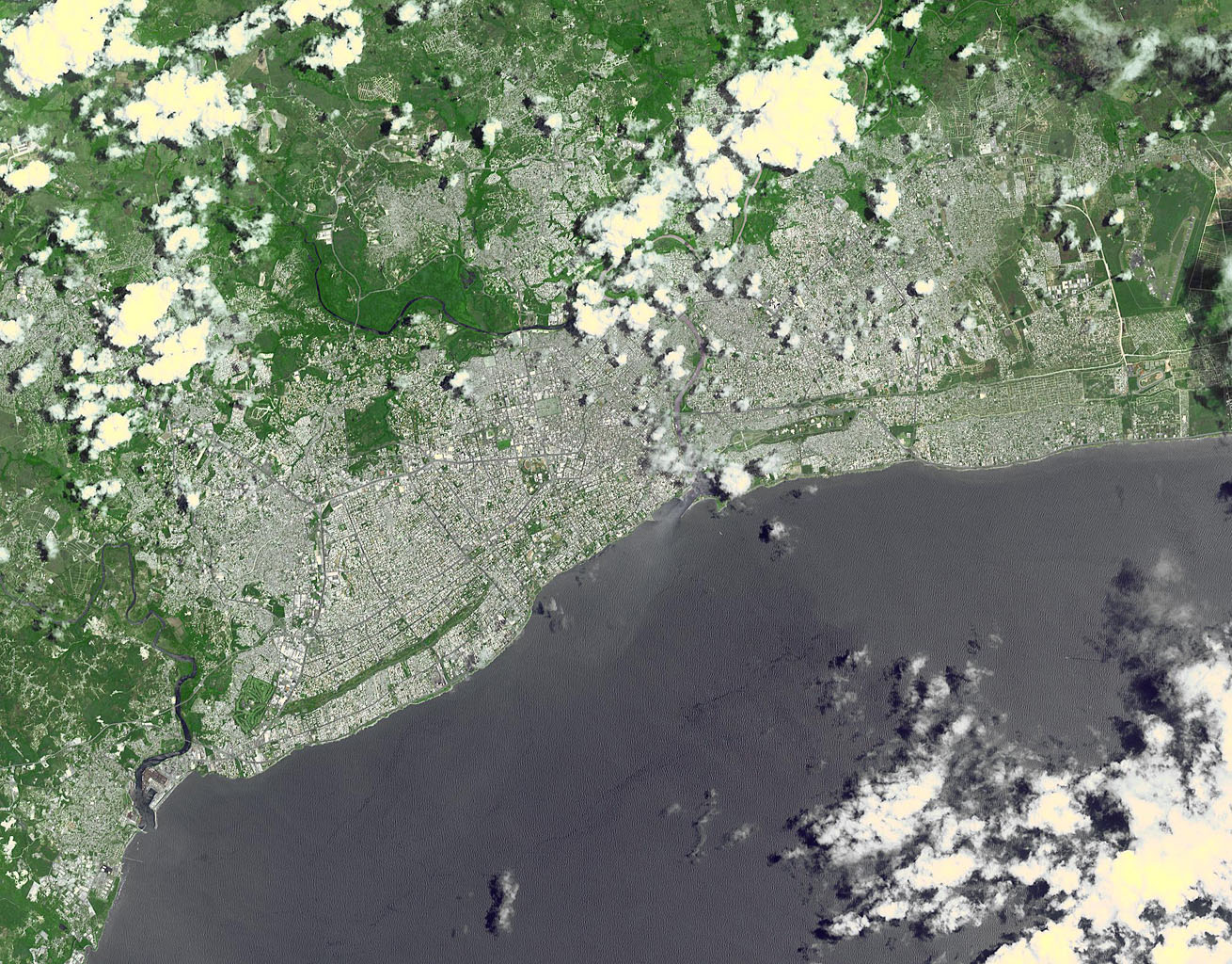 This image, acquired by NASA's Terra spacecraft, shows Santo Domingo, the capital of the Dominican Republic, founded in 1496 Christopher Columbus, it is the oldest continuously inhabited European settlement in the Americas.