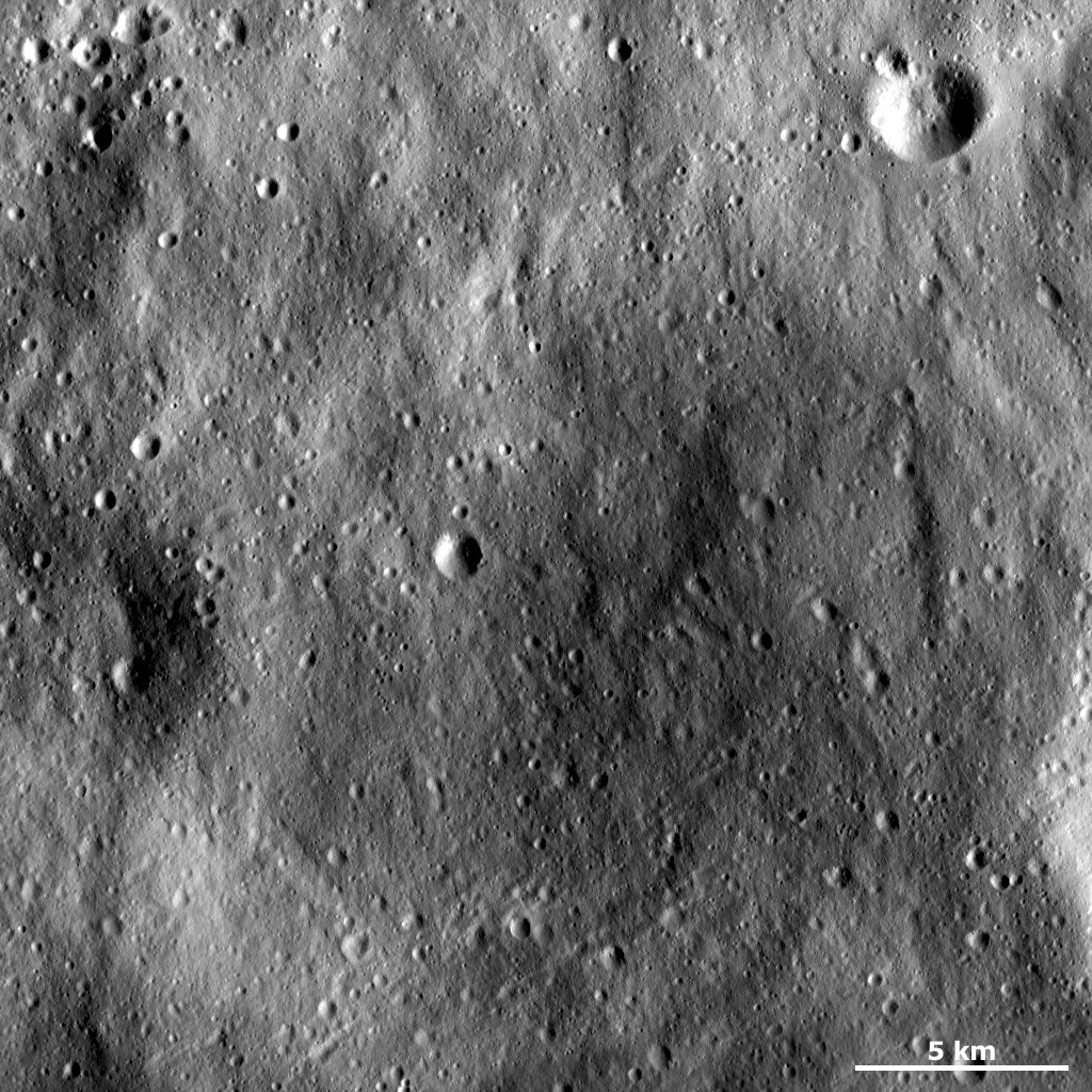 This image of asteroid Vesta from NASA's Dawn spacecraft shows an old, very degraded crater that is almost completely filled with regolith. Regolith is the fine-grained material that covers most of Vesta's surface.