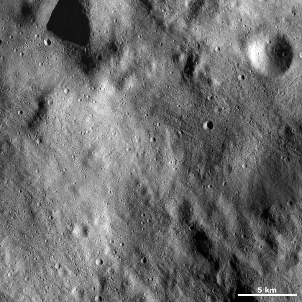 This image of asteroid Vesta from NASA's Dawn spacecraft shows a relatively smooth area of Vesta's surface. This region is smooth because it is mostly covered by fine-grained debris, known as regolith.
