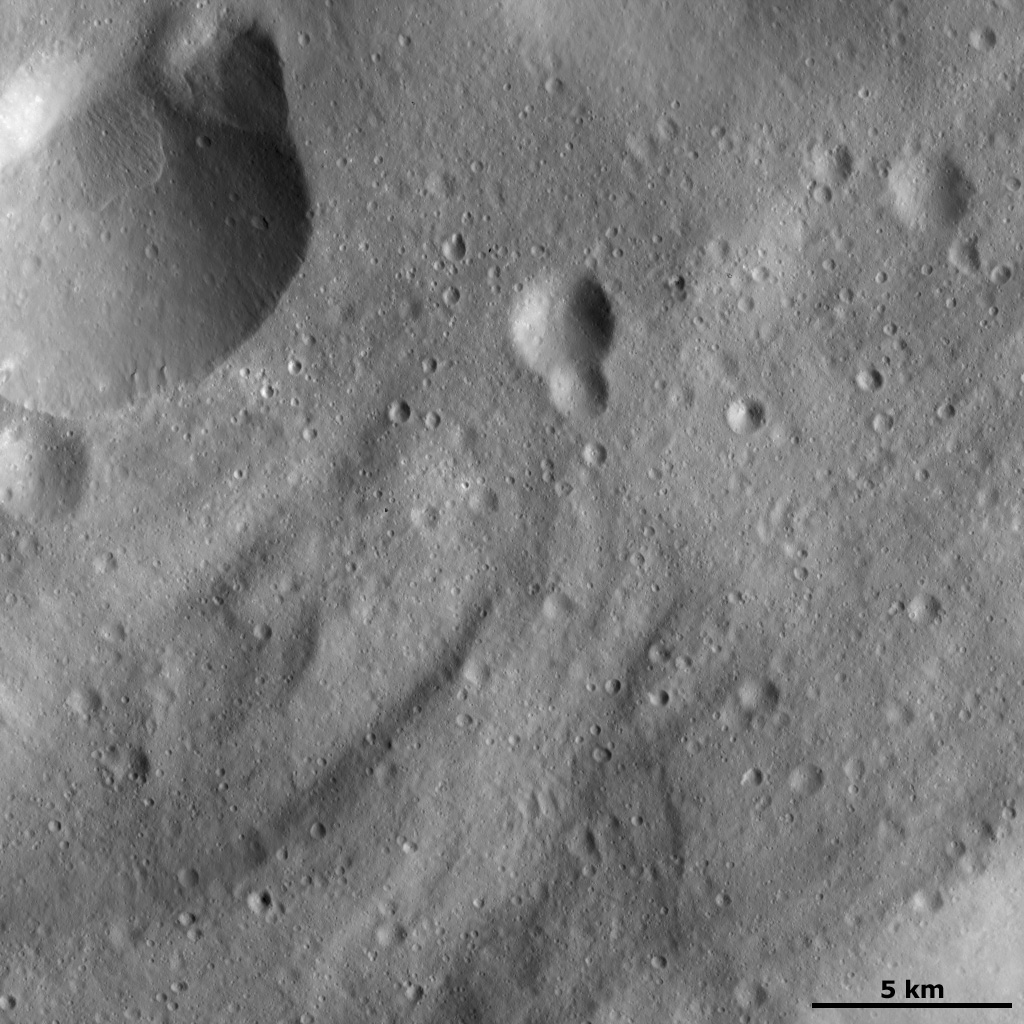 This image of asteroid Vesta from NASA's Dawn spacecraft shows many curved ridges that are typical of Vesta's southern hemisphere. This image is located in Vesta's Sextilia quadrangle, in Vesta's southern hemisphere.