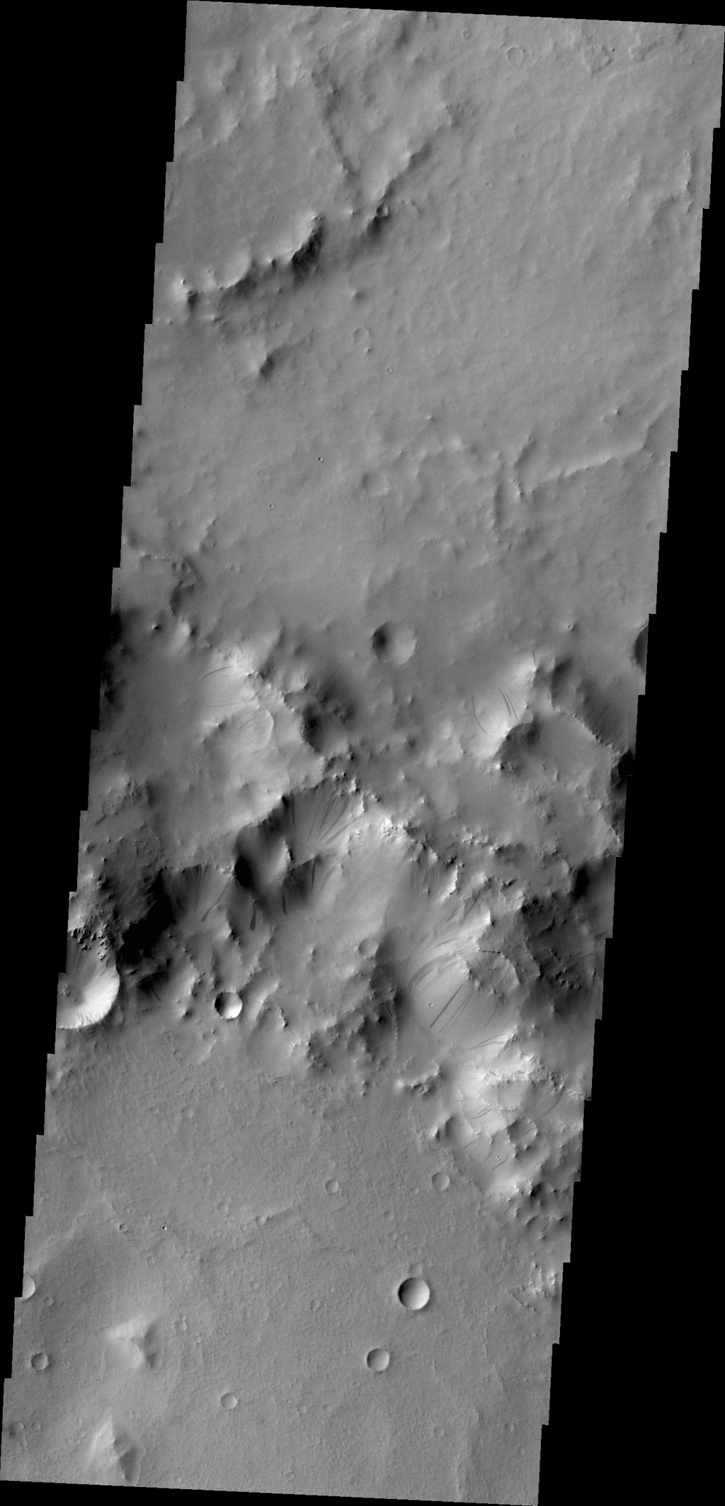 Gravity driven slope modification creates the dark marks on the crater rim in this unnamed crater in Terra Sabaea as seen by NASA's 2001 Mars Odyssey spacecraft.