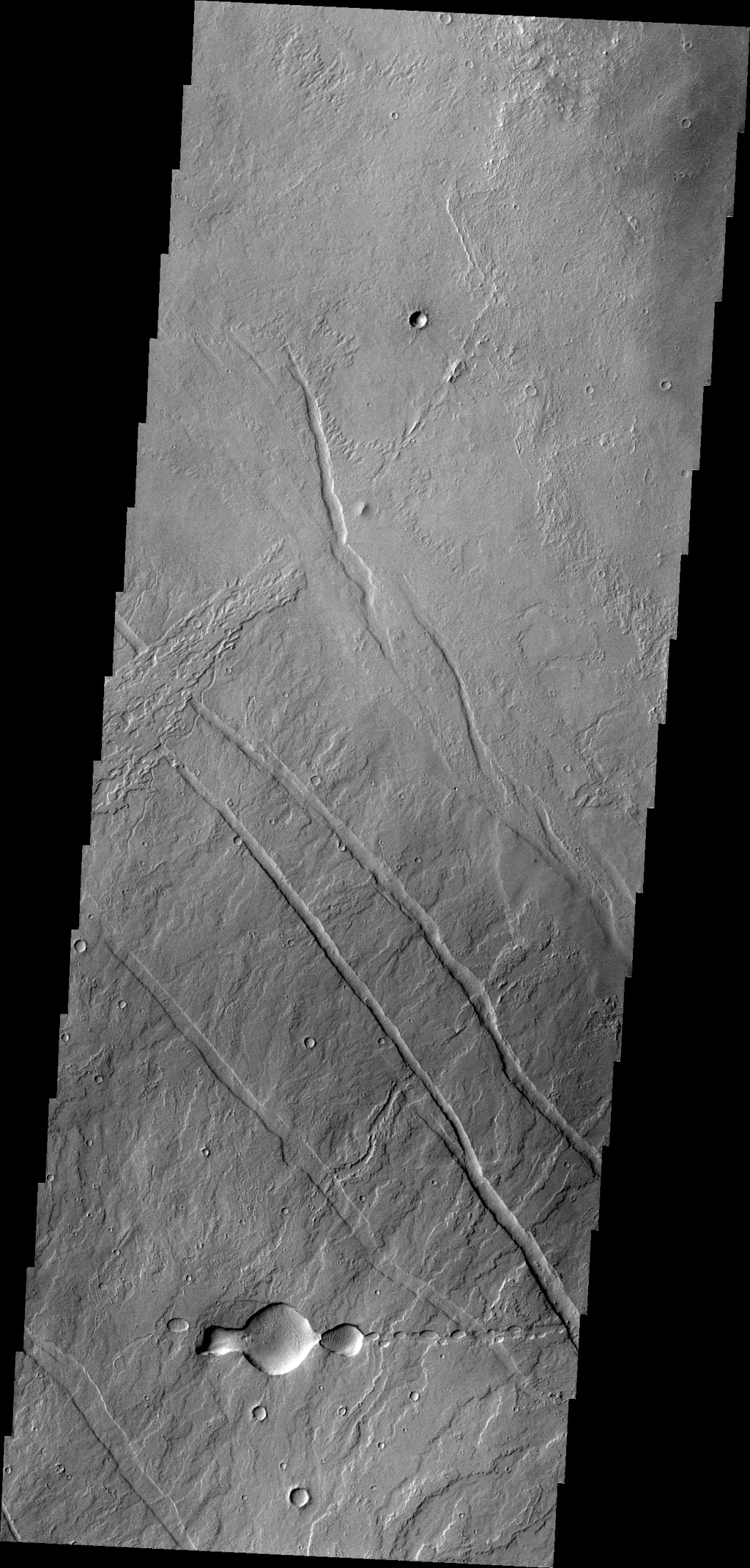 This image from NASA's 2001 Mars Odyssey spacecraft of the Tharsis region illustrates relative age relations. Fractures occurred in old lava flows and then younger lava flows covered the fractures.