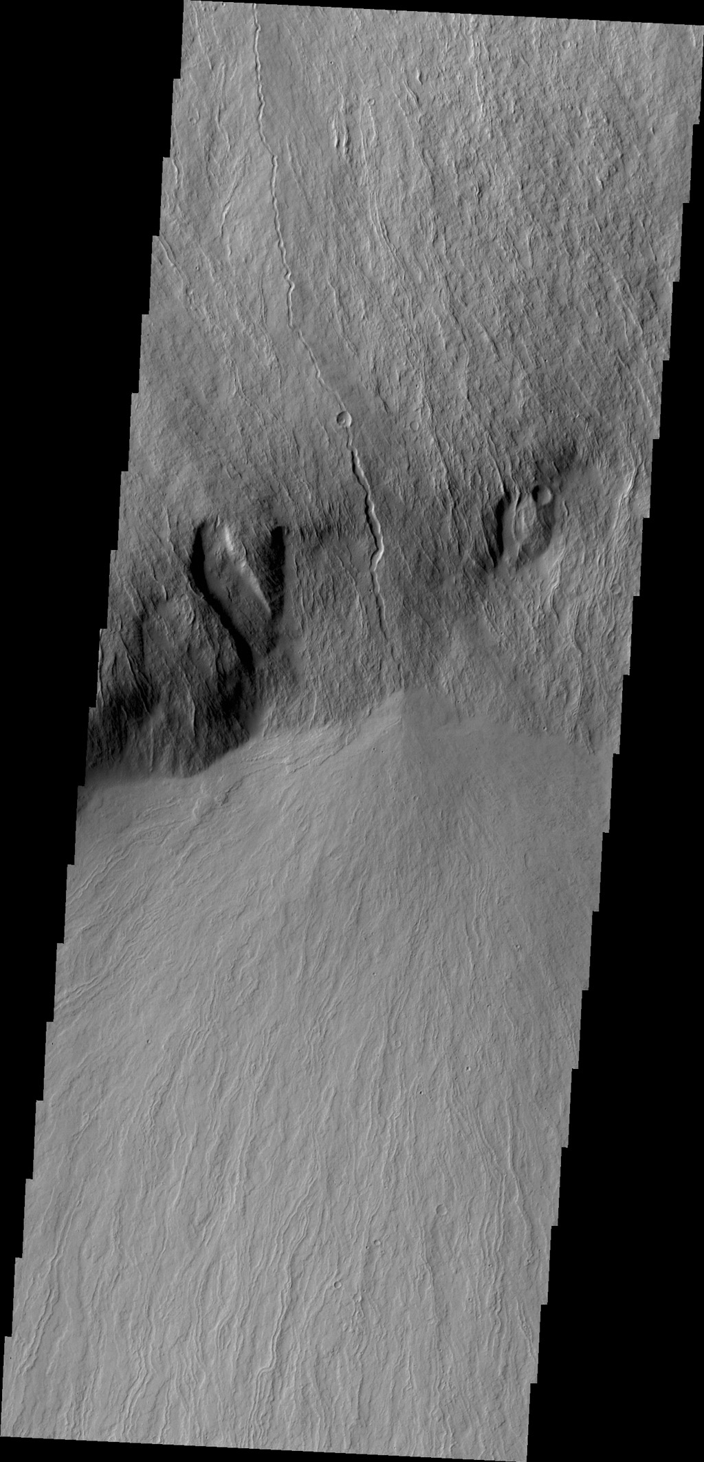 This image from NASA's 2001 Mars Odyssey spacecraft shows lava flows that cover the steep embankment called Olympus Rupes on the margin of Olympus Mons.