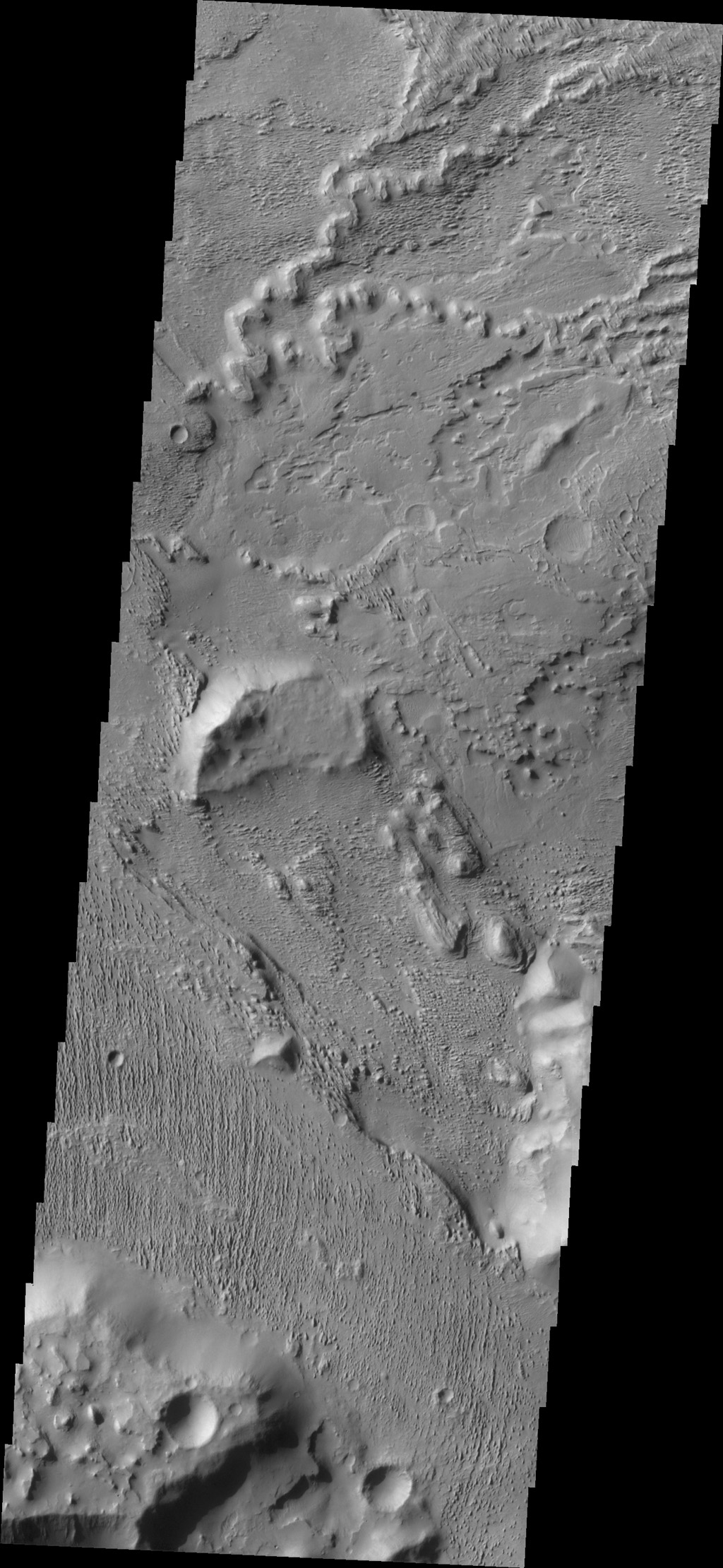 This complexly eroded region is part of Aeolis Planum with portions that appear to be layered material that has been eroded by wind action. This image is from NASA's 2001 Mars Odyssey spacecraft.