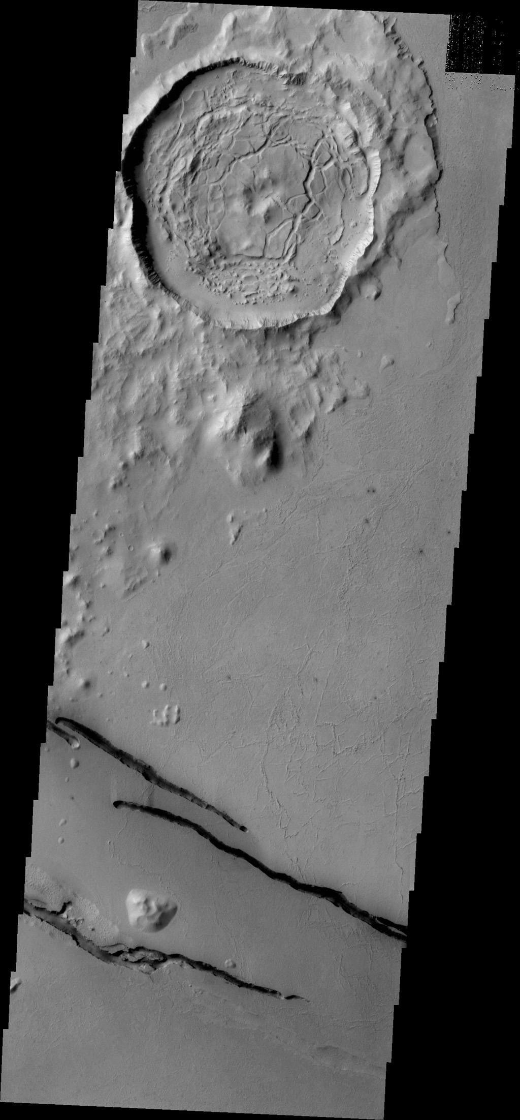 The dark fractures in this image from NASA's 2001 Mars Odyssey spacecraft are part of Cerberus Fossae.