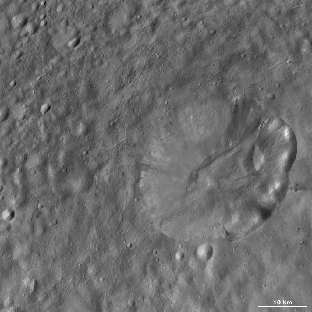 This image from NASA's Dawn spacecraft of asteroid Vesta shows Octavia crater, located in Vesta's Marcia quadrangle, just south of Vesta's equator. Octavia's rim is fresher on the right side and more degraded on the left side.