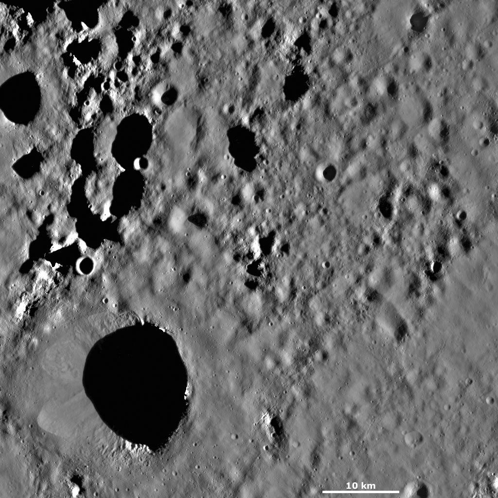 This image from NASA's Dawn spacecraft of asteroid Vesta shows Scantia crater, located in Vesta's Floronia quadrangle, in Vesta's northern hemisphere.