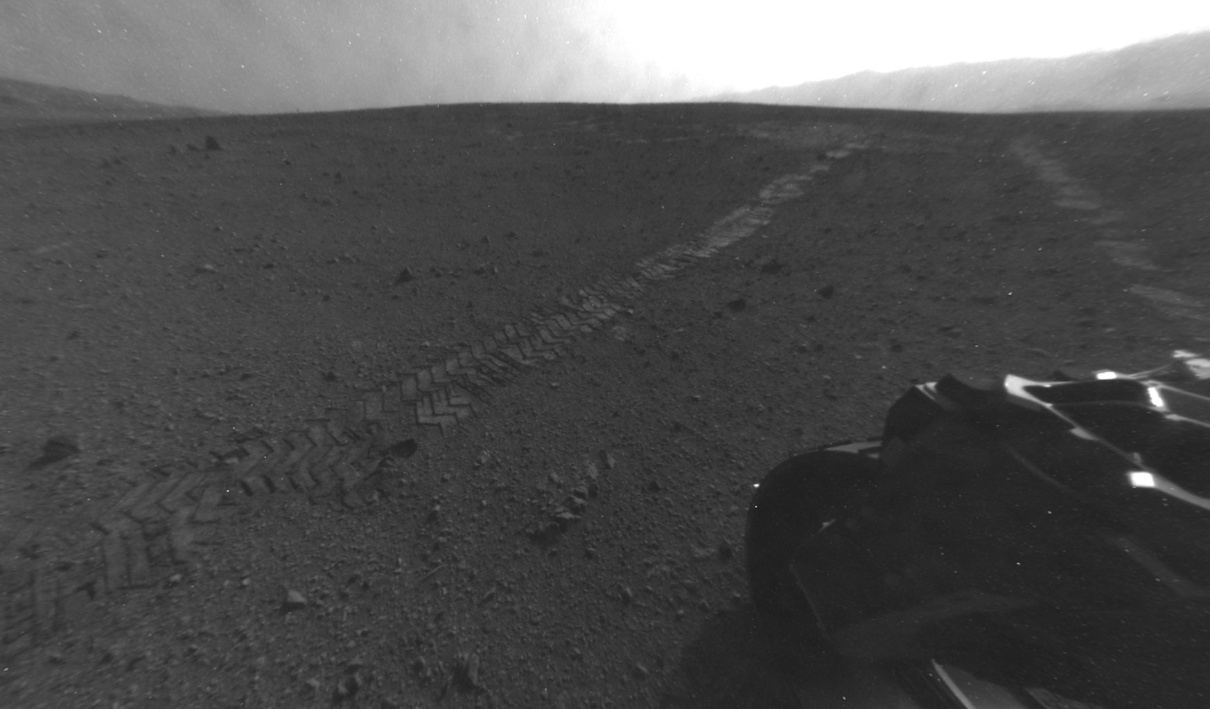On Aug. 28, 2012, during the 22nd Martian day, or sol, after landing on Mars, NASA's Curiosity rover drove about 52 feet (16 meters) eastward, the longest drive of the mission so far. The drive imprinted the wheel tracks visible in this image.