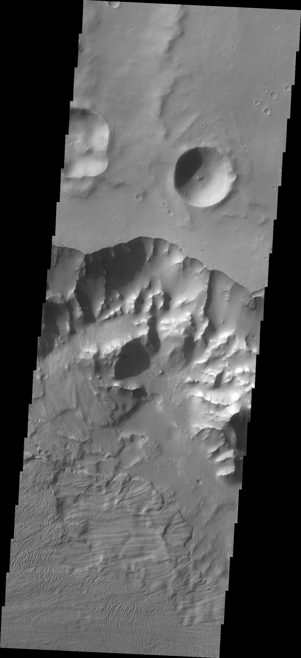 Multiple landslide deposits are visible in this image of Ganges Chasma captured by NASA's 2001 Mars Odyssey spacecraft.