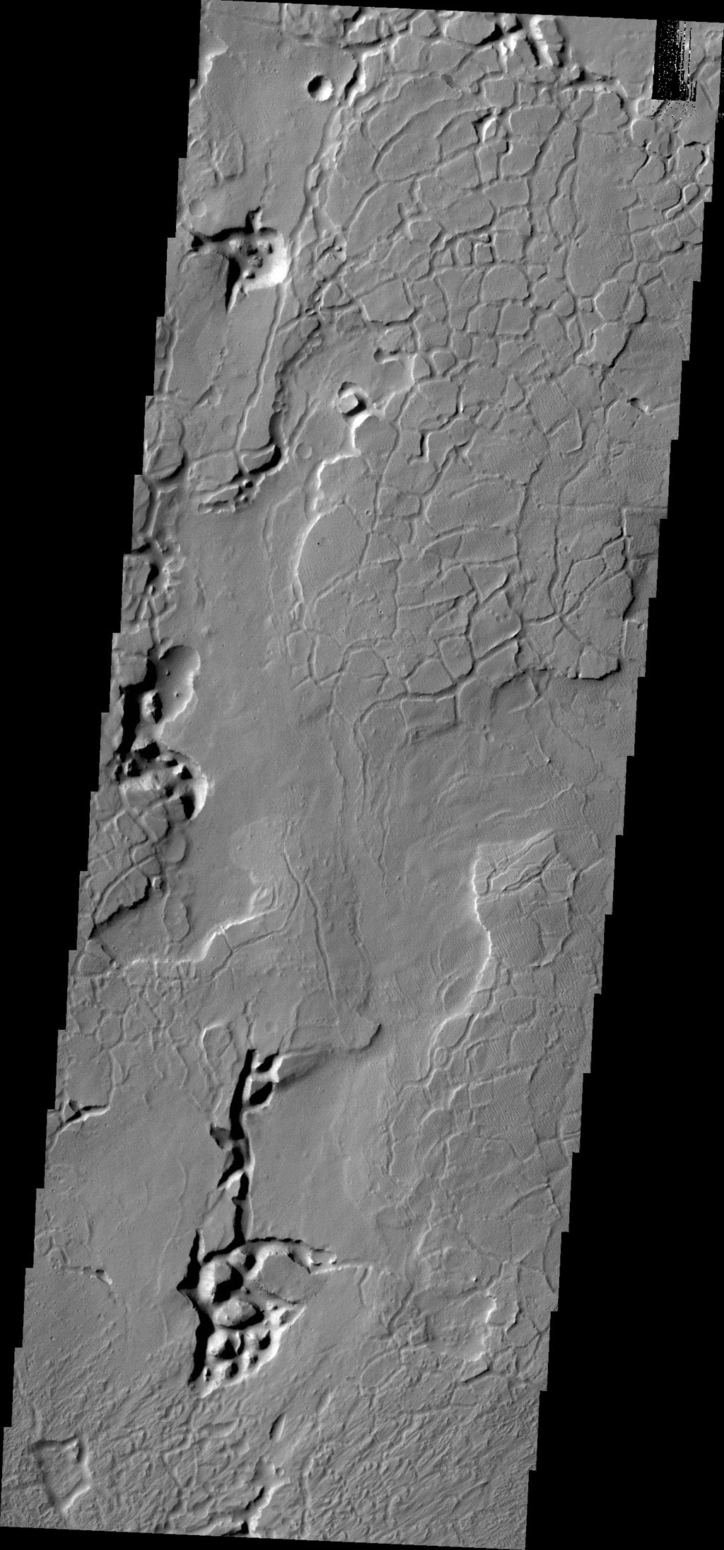 Tectonics played the major role in shaping the surface of this image captured by NASA's 2001 Mars Odyssey spacecraft. This image contains arcuate fractures and isolated depressions containing chaos.