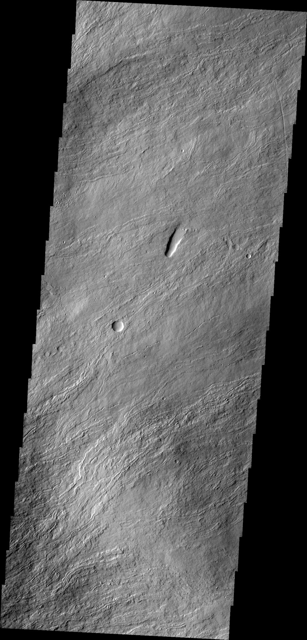The narrow volcanic flows in this image captured by NASA's 2001 Mars Odyssey spacecraft are located on the northeastern flank of Olympus Mons.