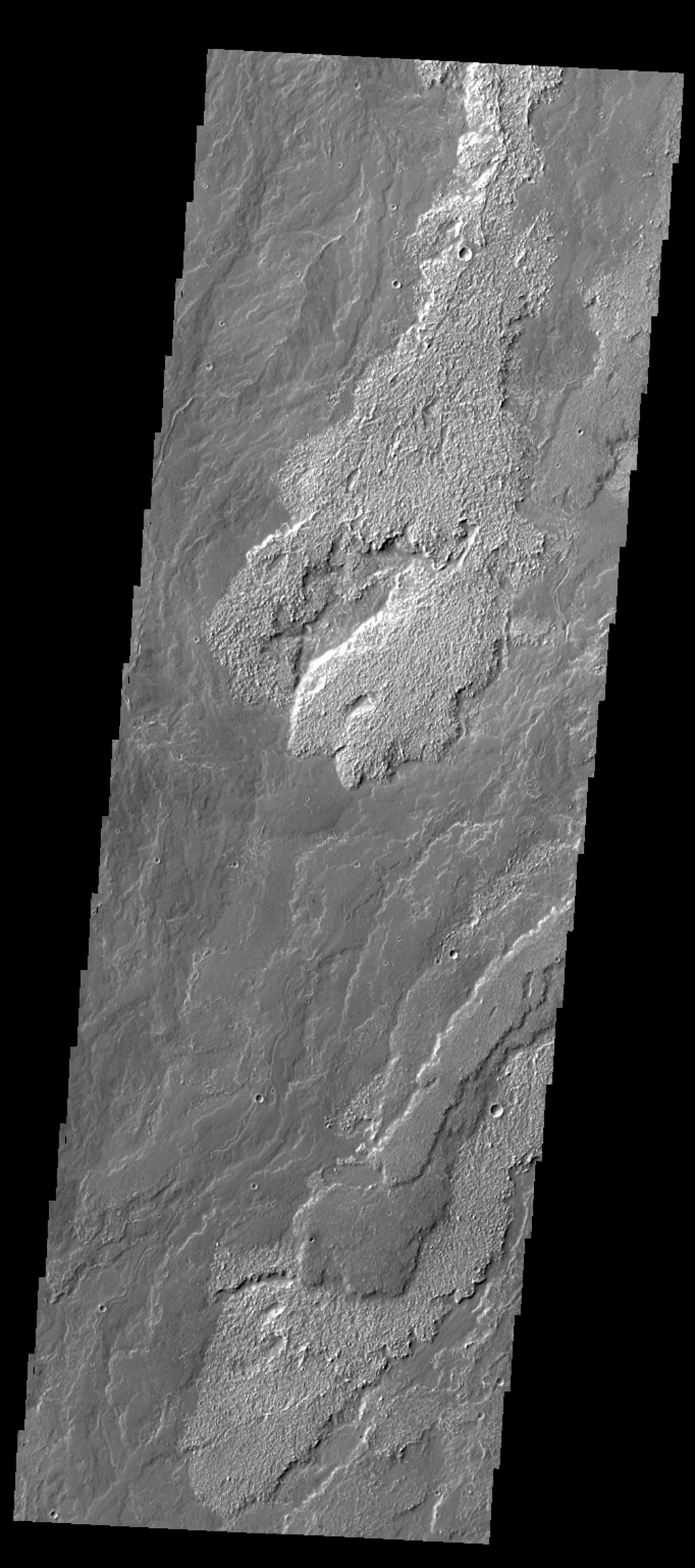 Daedalia Planum is comprised of enormous amounts of lava flows, the majority of which appear to be related to Arsia Mons. In this image from NASA's 2001 Mars Odyssey spacecraft, multiple overlapping flows are evident.