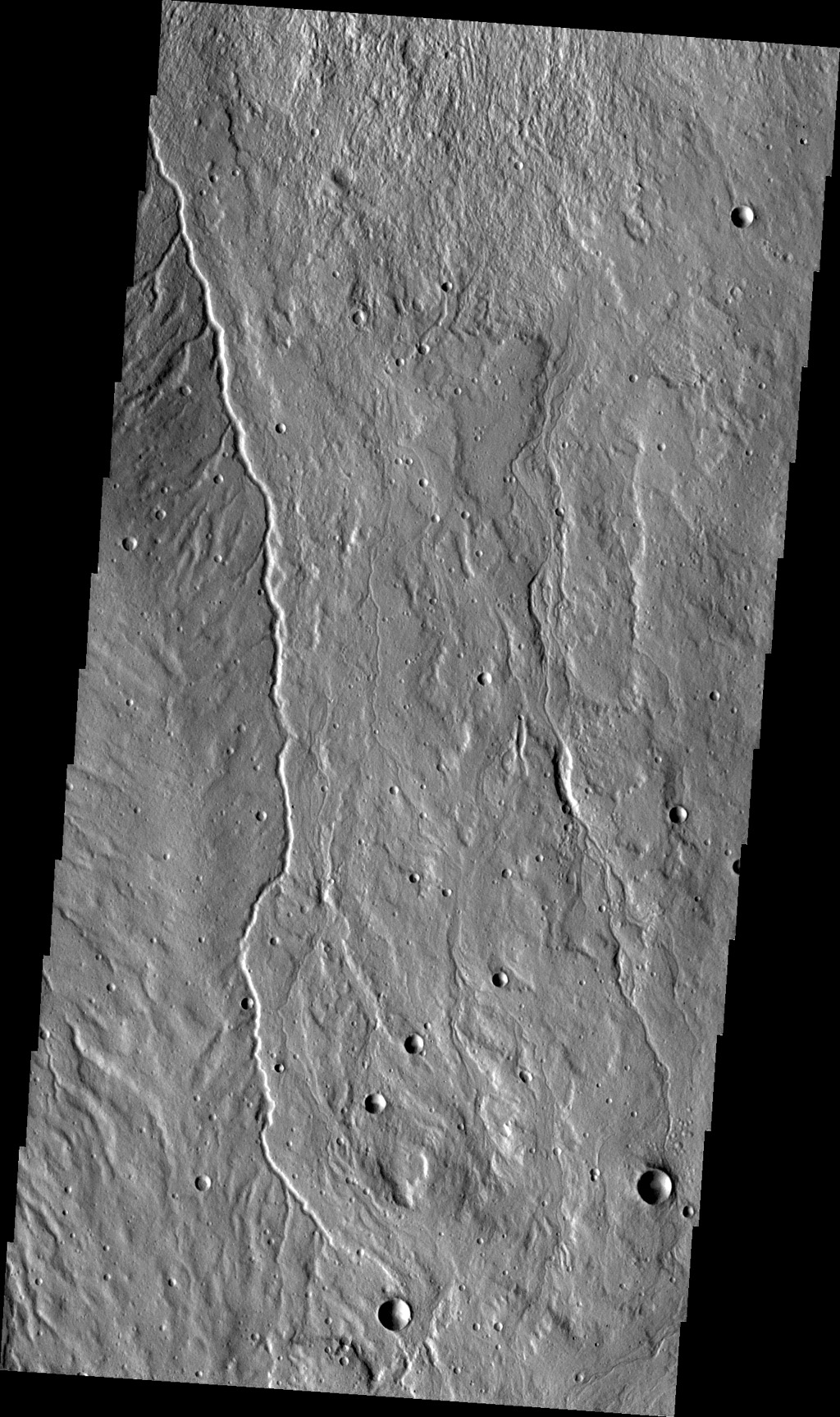 This small channel is located on the western flank of Alba Mons. This image is from NASA's 2001 Mars Odyssey spacecraft.