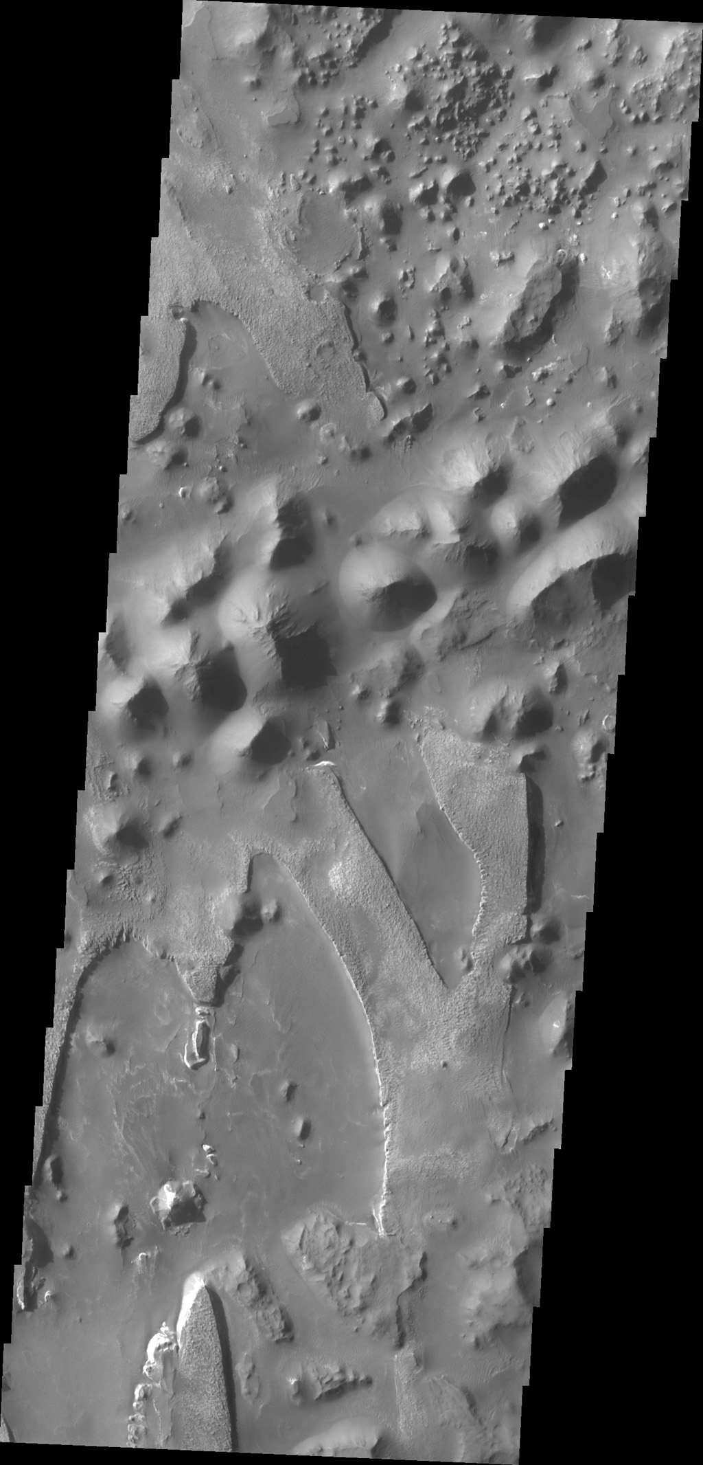 The unusual and apparently layered surface in this image from NASA's 2001 Mars Odyssey spacecraft is located in Aureum Chaos.