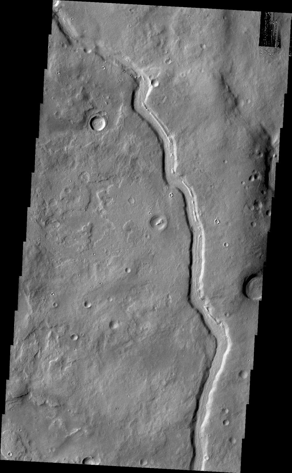 The unnamed channel in this image captured by NASA's 2001 Mars Odyssey spacecraft is located in Terra Sabaea.