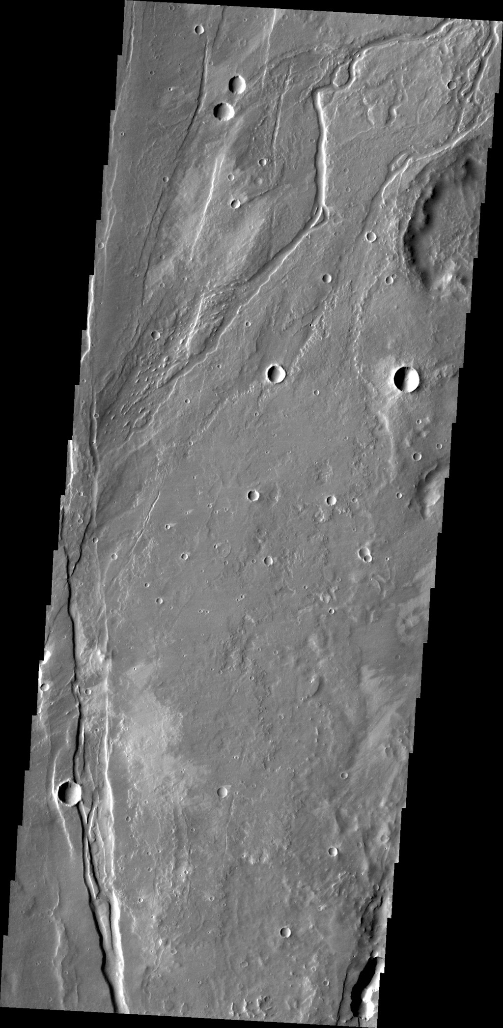 The small channel in this image captured by is located in volcanic flows in the northern part of Tractus Fossae.