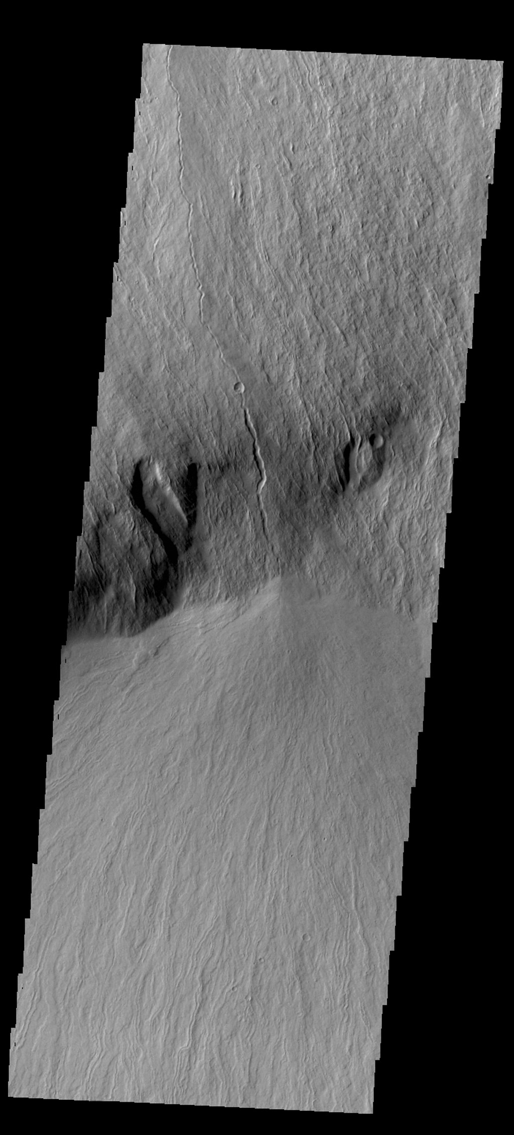 Olympus Mons is surrounded by a steep escarpment called Olympus Rupes. This image from NASA's 2001 Mars Odyssey spacecraft shows this escarpment and lava flows that plunged over it.