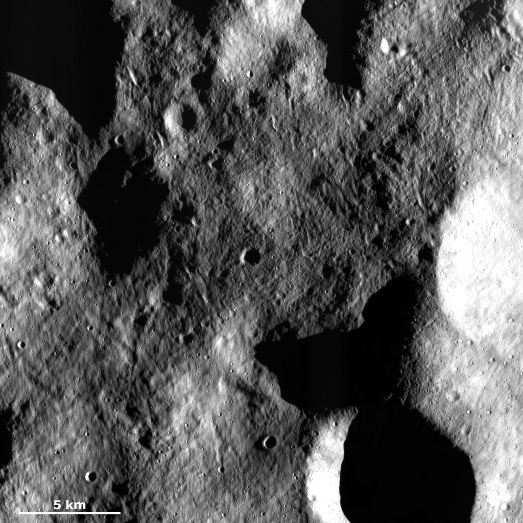 This image from NASA's Dawn spacecraft of asteroid Vesta shows a part of the surface in Vesta's northern hemisphere, which is scoured by many grooves with different orientations.