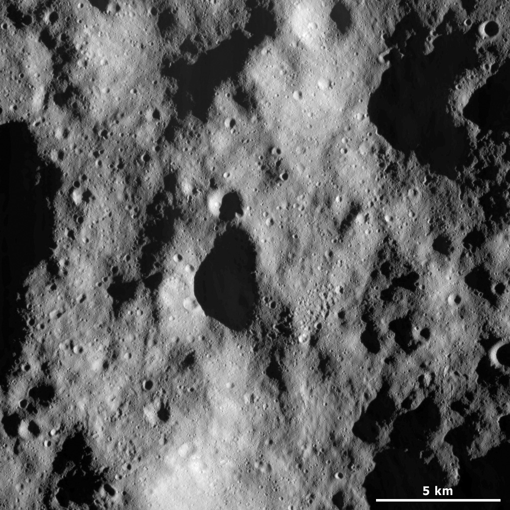 This image from NASA's Dawn spacecraft shows a part of the heavily cratered terrain in asteroid Vesta's northern hemisphere. Some of the craters have fresh, sharp rims, which suggests that they are reasonably young.