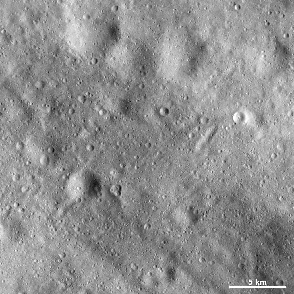 This image from NASA's Dawn spacecraft shows many craters of different sizes and states of preservation on asteroid Vesta's surface. In the top of the image there are four large, very degraded craters.