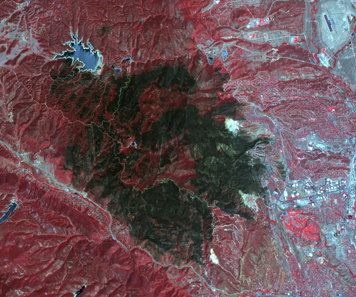 NASA's Terra spacecraft acquired this image of the Waldo Canyon Fire, west of Colorado Springs, Colo., being called the worst fire in Colorado history. Healthy vegetation is red, water is dark blue, streets and buildings are gray, and the burned areas are