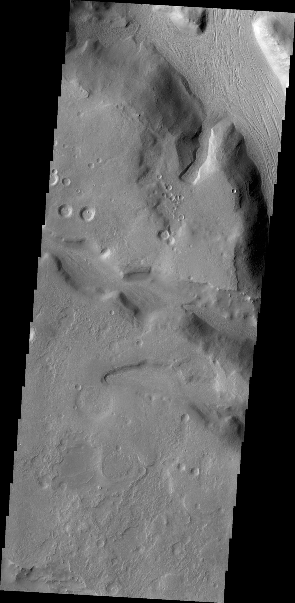 This image from NASA's 2001 Mars Odyssey spacecraft shows a portion of Naktong Vallis, located in Terra Sabaea on Mars.