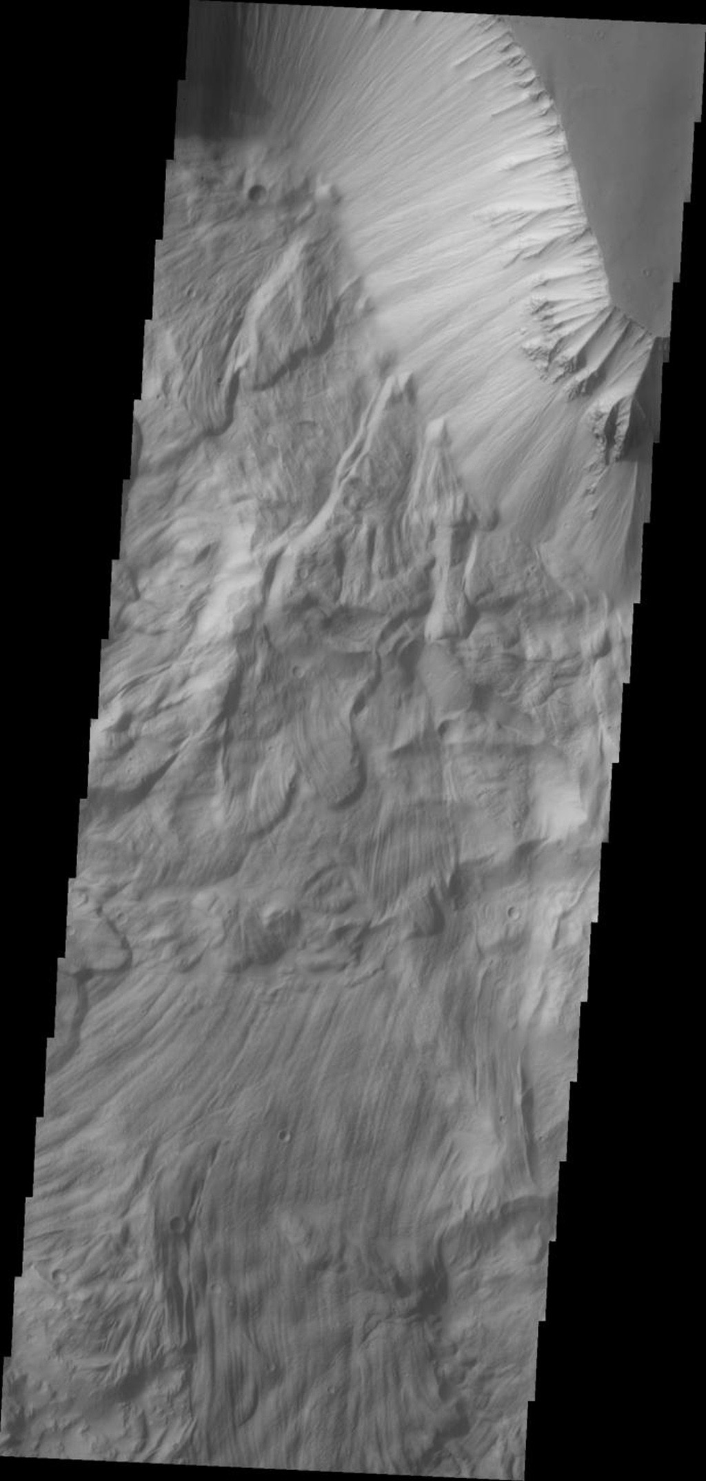The massive, complex landslide deposits in this image from NASA's 2001 Mars Odyssey spacecraft are located on the northern slope of Ophir Chasma on Mars.