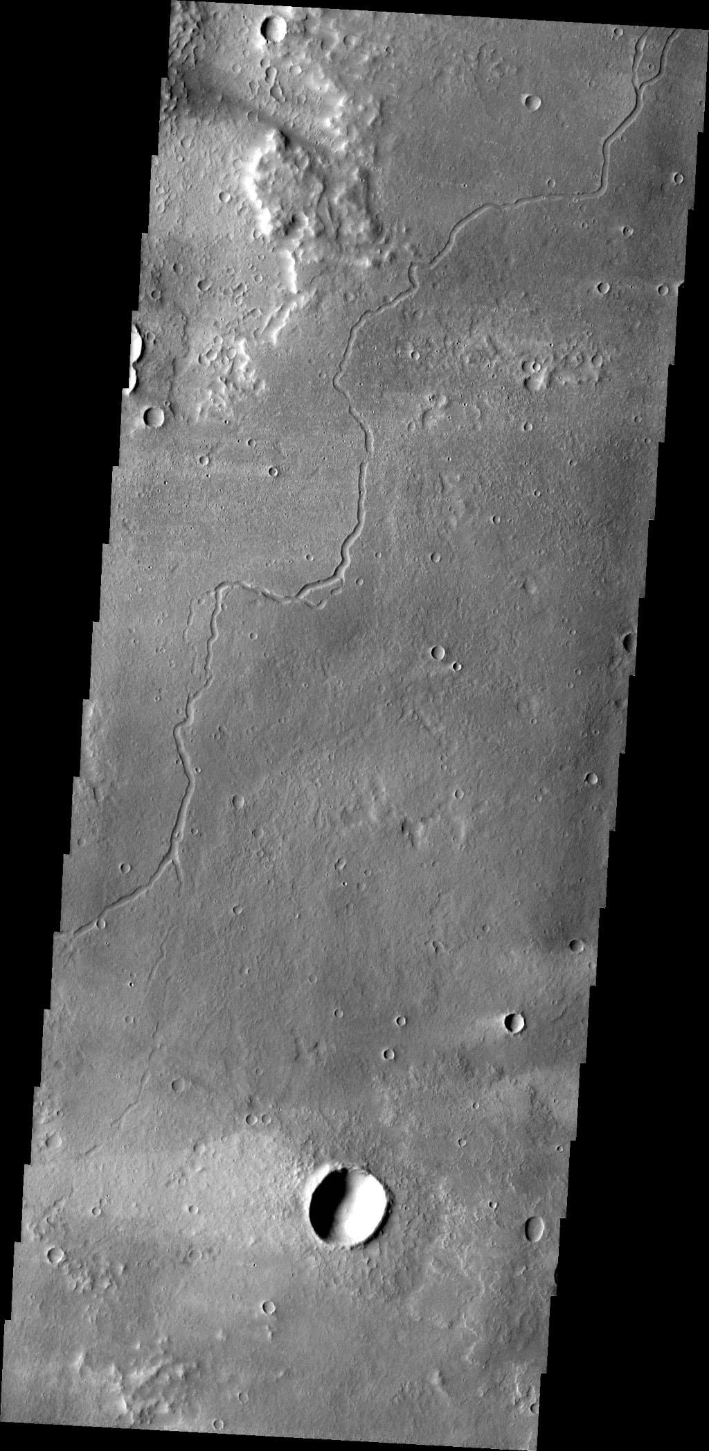 This image from NASA's 2001 Mars Odyssey spacecraft shows a channel carved by lava on Mars. This channel is located northeast of Olympus Mons.